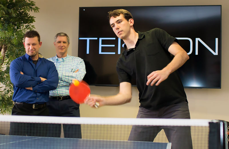 Teknion team members playing ping pong