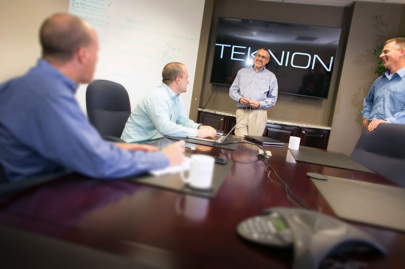 Angled photo from conference table with Steve David Larry and Jonathan Teknion Data Solutions team learn more about Teknion