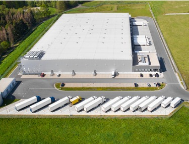 loading-bay-truck-parking-lot-industrial-building-logistics-aerial-picture-id1149754751